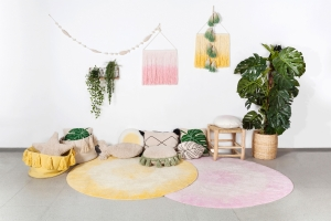 Circular tie-dye rugs in pink and yellow by Lorena Canals