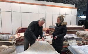 Two people choosing the perfect rug