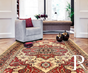 Red and beige rug with a traditional geometric floral design
