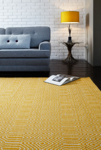 mustard yellow rug with an woven design
