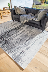 black and white monochrome rug with an abstract design