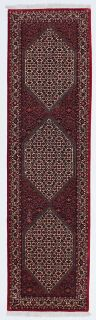 red and black persian rug with geometric design