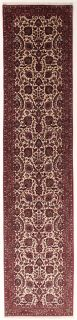 Red and cream persian runner with traditional floral design