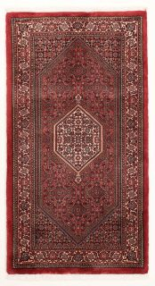 Red and cream persian rug with traditional floral design