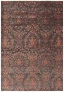 Polypropylene rug with geometric triangle pattern in grey, cream and orange
