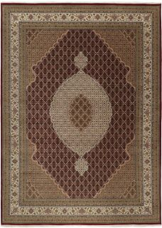 Authentic Oriental rug with traditional geometric and floral design in brown and red