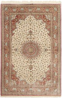 Authentic persian rug with a traditional floral design in coral