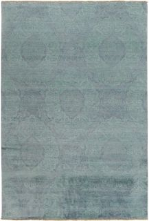Authentic oriental rug with a damask pattern in blue