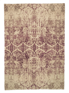 pink and beige rug with an abstract damask pattern