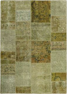 Green Persian rug with a patchwork design