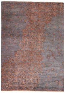 Authentic oriental rug with a damask pattern in Orange