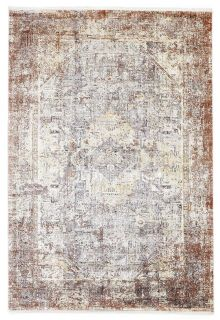 large area rug with distressed design in beige