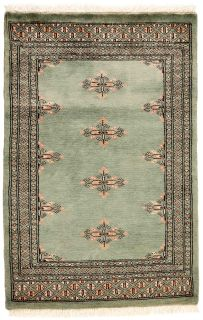 green oriental rug with traditional pattern