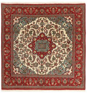 Authentic persian rug with a traditional floral design in red and beige