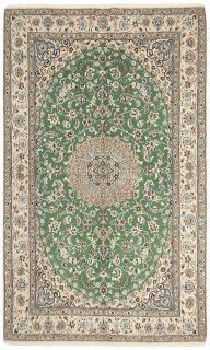 Authentic oriental rug with traditional floral design in green
