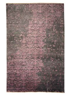 Authentic oriental rug with a damask pattern in black and purple