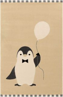 Beige children's rug with a white and blue striped border, decorated with a white and black penguin holding a balloon.