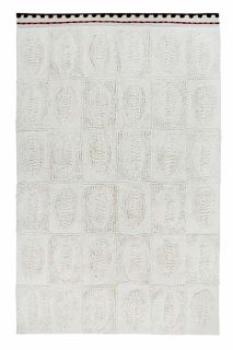 cream area rug with embossed shell design