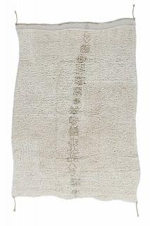 textured cream area rug with tribal design
