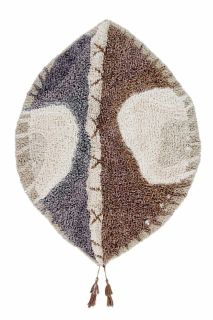 brown and grey oval shaped rug with tribal design
