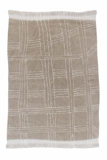 beige area rug with tribal design