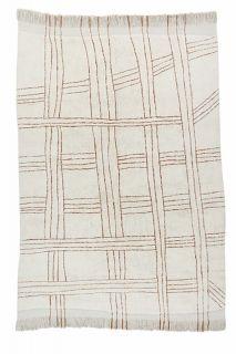 cream area rug with tribal design