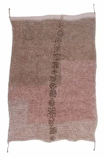 textured pink area rug with tribal design