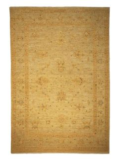 Authentic oriental rug with delicate floral pattern in gold and beige