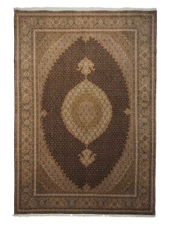 Authentic persian rug with traditional floral design in red, brown and beige