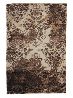 Authentic oriental rug with a damask pattern in beige and brown