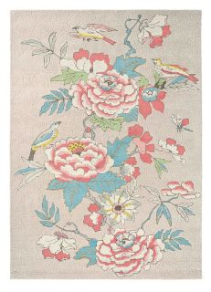Rectangular pink rug decorated with coral and blue peonies, roses and birds