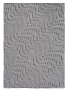 Rectangular grey rug with engraved leaf pattern