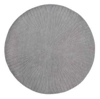 Round grey rug with engraved botanical pattern