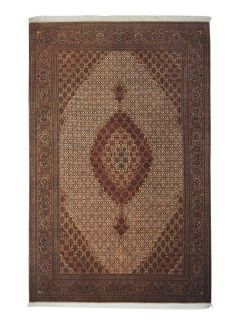 Authentic persian rug with traditional floral design in brown and beige