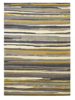 Rectangular rug with abstract stripe pattern in beige, brown, cream and gold hues