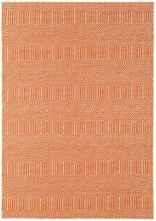 orange and white woven rug with aztec chevron pattern