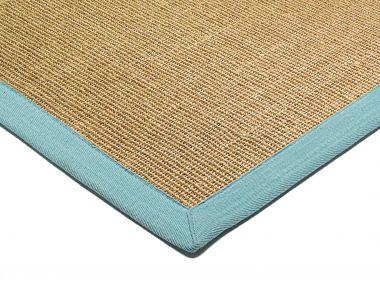 beige sisal rug with a blue border