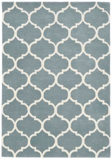 duck egg blue geometric rug with an ogee pattern