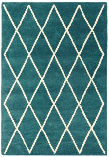 teal green geometric rug with a moroccan berber design