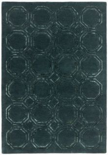 green rug with a geometric pattern
