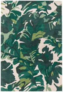 area rug with a green palm leaf design