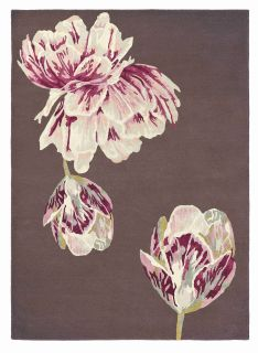 Rectangular purple rug with large white and pink flower motifs