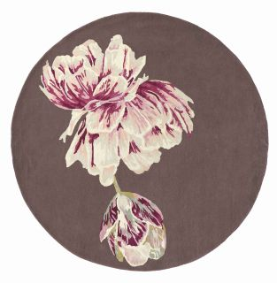 Round purple rug with large white and pink flower motif