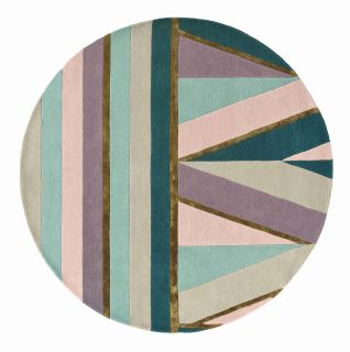 Round rug with geometric stripe pattern in green, teal, grey and purple. Gold details.