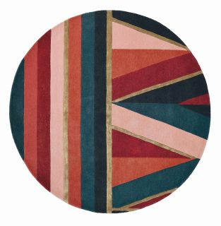 Round rug with geometric stripe pattern in green, coral, nude and red. Gold details.