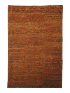 Authentic oriental rug with a damask pattern in orange and brown