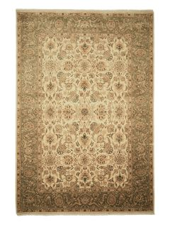 Authentic oriental rug with delicate floral pattern in green and beige