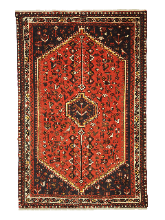 Authentic persian rug with a traditional tribal geometric pattern in red