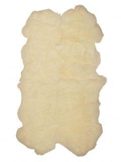 Fluffy cream sheepskin rug