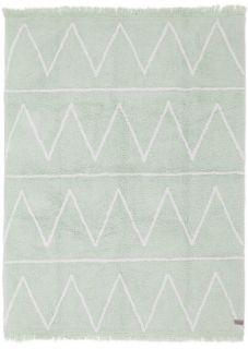 Rectangular green rug decorated with white zig-zag design and fringed border